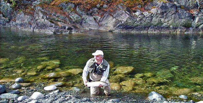 Wolfgang Fabisch with a good steelhead at fly fishing