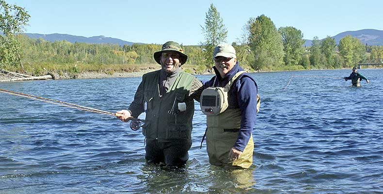 Friends fly fish together on the Bulkley River